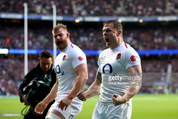 Chris Ashton of England celebrates scoring his team's first try during the Quilter International match between England and New Zealand at Twickenham...