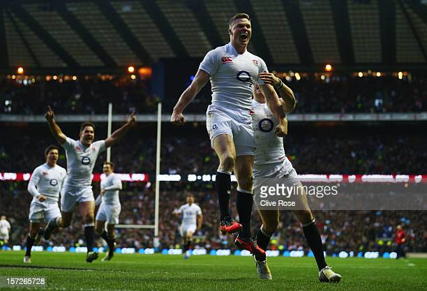 Chris Ashton of England celebrates scoring his try during the QBE International match between England and New Zealand at Twickenham Stadium on...