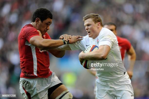 Chris Ashton of England hands off Toby Faletau of Wales during an RBS 6 Nations match between England and Wales at Twickenham Stadium on February 25...