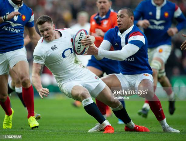 Chris Ashton of England is tackled by Gael Fickou of France during the Guinness Six Nations match between England and France at Twickenham Stadium on...