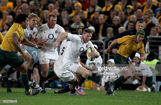 Chris Ashton of England makes a break to score the second try during the Cook Cup Test Match between the Australian Wallabies and England at ANZ...
