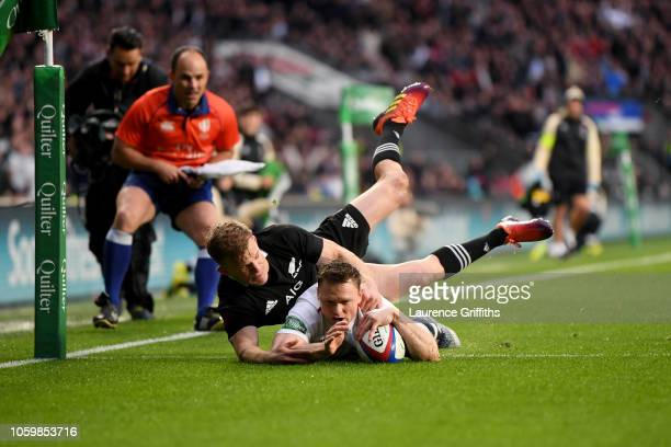 Chris Ashton of England touches down for the first try whilst being tackled by Damian McKenzie of New Zealand All Blacks during the Quilter...