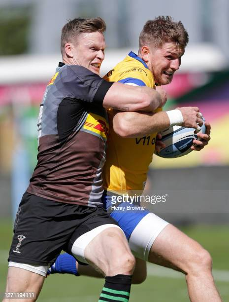 Chris Ashton of Harlequins tackles Ruaridh McConnochie of Bath Rugby during the Gallagher Premiership Rugby match between Harlequins and Bath Rugby...