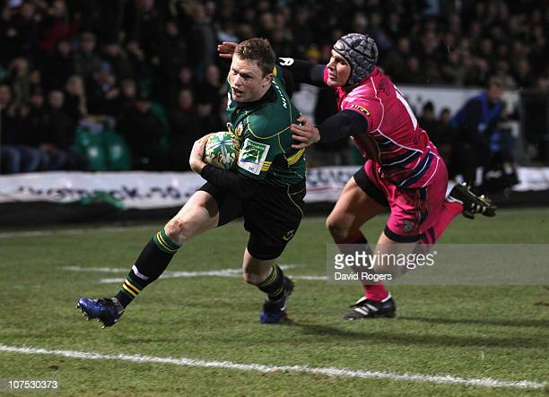 Chris Ashton of Northampton dives over to score a try during the Heineken Cup Pool 1 match between Northampton Saints and Cardiff Blues at Franklin's...