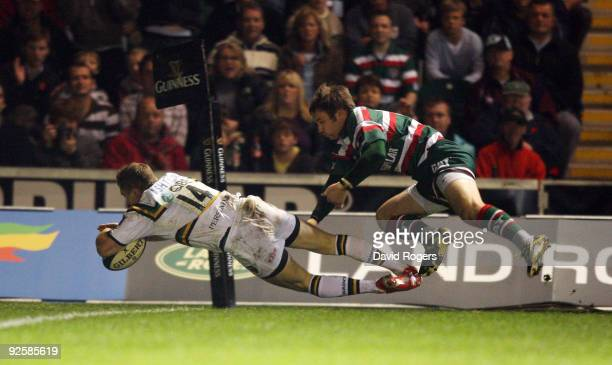Chris Ashton of Northampton dives over to score a try during the Guinness Premiership match between Leicester Tigers and Northampton Saints at...