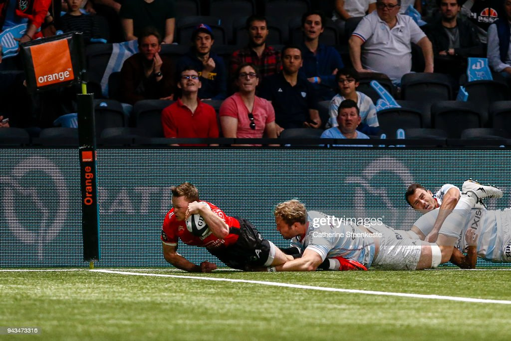 Chris Ashton #14 of RC Toulon is tackled just short of the try line by Antonie Claassen #8 of Racing 92 during the French Top 14 match between Racing 92 and RC Toulon at U Arena on April 8, 2018 in Nanterre, France.