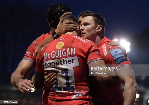 Chris Ashton of Sale Sharks celebrates his sides second try with scorer Byron McGuigan of Sale Sharks during the Gallagher Premiership Rugby match...