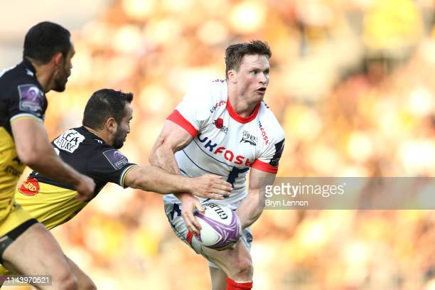 Chris Ashton of Sale Sharks is tackled by Alexi Bales of Stade Rochelais during the Challenge Cup Semi Final match between La Rochelle and Sale...