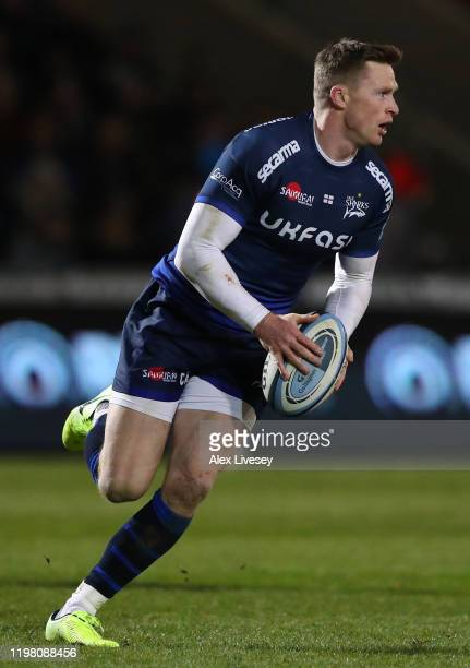 Chris Ashton of Sale Sharks runs with the ball during the Gallagher Premiership Rugby match between Sale Sharks and Harlequins at AJ Bell Stadium on...
