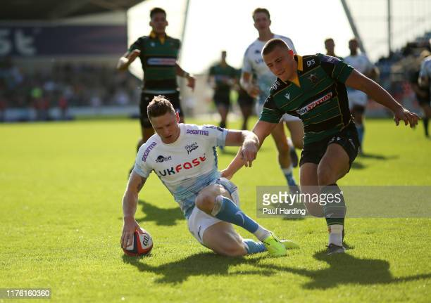 Chris Ashton of Sale Sharks scores their fourth try during the Premiership Rugby Cup First Round match between Sale Sharks and Northampton Saints at...