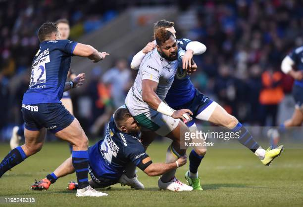 Chris Ashton of Sale Sharks tackles Taqele Naiyaravoro of Northampton Saints during the Gallagher Premiership Rugby match between Sale Sharks and...