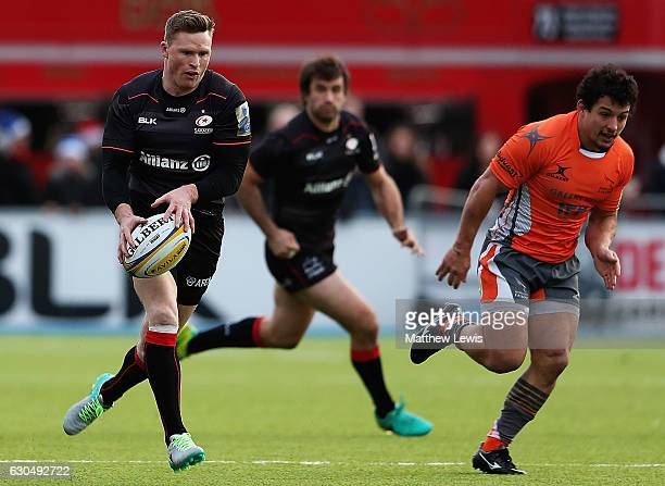 Chris Ashton of Saracens attacks the Newcastle defence during the Aviva Premiership match between Saracens and Newcastle Falcons at Allianz Park on...