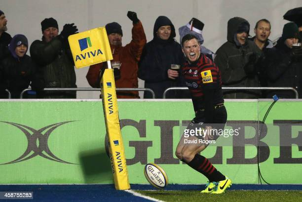 Chris Ashton of Saracens celebrates after scoring a try during the Aviva Premiership match between Saracens and Leicester Tigers at Allianz Park on...