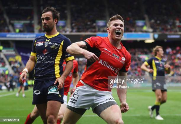Chris Ashton of Saracens celebrates after scoring the opening try during the European Rugby Champions Cup Final between ASM Clermont Auvergne and...