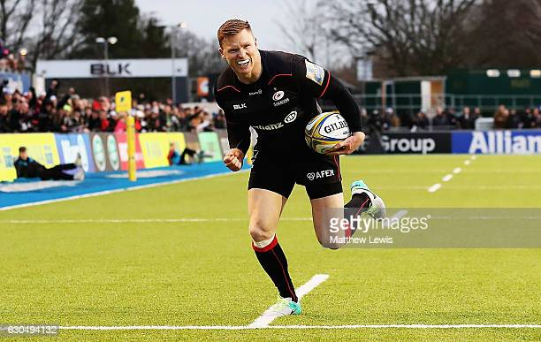 Chris Ashton of Saracens celebrates as he scores a try during the Aviva Premiership match between Saracens and Newcastle Falcons at Allianz Park on...
