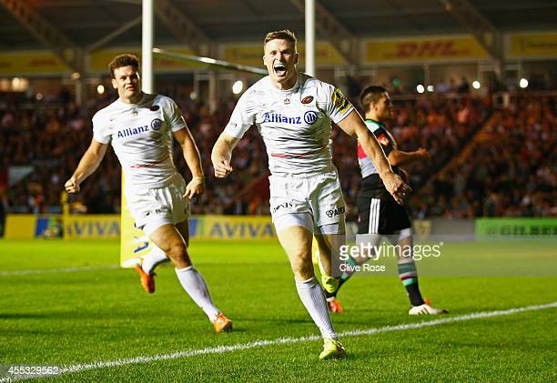 Chris Ashton of Saracens celebrates his try during the Aviva Premiership match between Harlequins and Saracens at Twickenham Stoop on September 12...