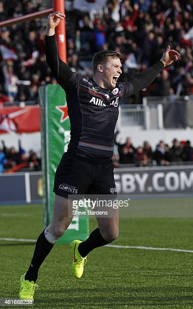 Chris Ashton of Saracens celebrates scoring a try during the European Rugby Champions Cup pool one match between Saracens and Munster at Allianz Park...