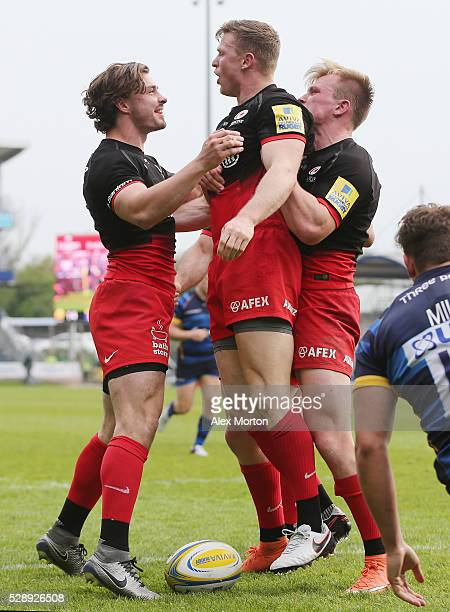 Chris Ashton of Saracens celebrates scoring their fifth try during the Aviva Premiership match between Worcester Warriors and Saracens at Sixways...