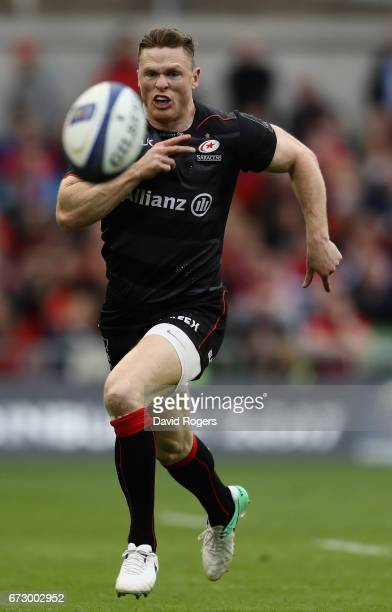 Chris Ashton of Saracens chases after the loose ball during the European Rugby Champions Cup semi final match between Munster and Saracens at the...