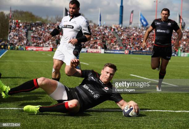 Chris Ashton of Saracens diver over to score his second try during the European Rugby Champions Cup match between Saracens and Glasgow Warriors at...