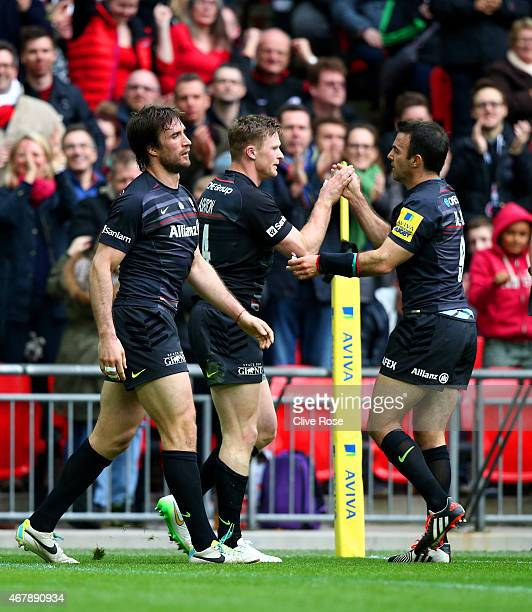 Chris Ashton of Saracens is congratulated by teammate Neil de Kock of Saracens after scoring his team's second try during the Aviva Premiership match...