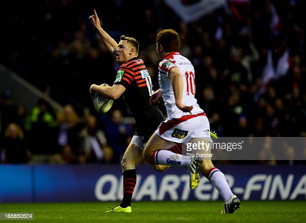 Chris Ashton of Saracens outpaces Paddy Jackson of Ulster to score his team's second try during the Heineken Cup quarter final match between Saracens...