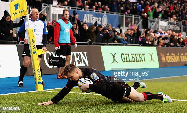 Chris Ashton of Saracens scores a try during the Aviva Premiership match between Saracens and Newcastle Falcons at Allianz Park on December 24 2016...