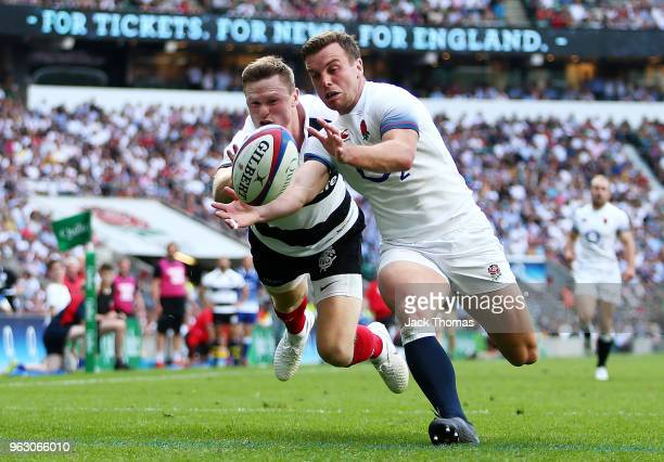 Chris Ashton of the Barbarians and George Ford of England compete for the ball as Chris Ashton attempts to score a try which was reviewed and given a...