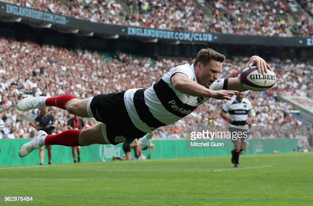 Chris Ashton of The Barbarians dives over the line to score a try during the Quilter Cup match between England and Barbarians at Twickenham Stadium...