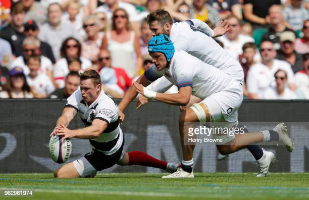 Chris Ashton of the Barbarians scores their second try during the Quilter Cup match between England and Barbarians at Twickenham Stadium on May 27...