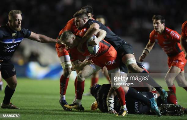 Chris Ashton of Toulon is tackled by Elliot Stooke during the European Rugby Champions Cup match between RC Toulon and Bath Rugby at Stade Felix...