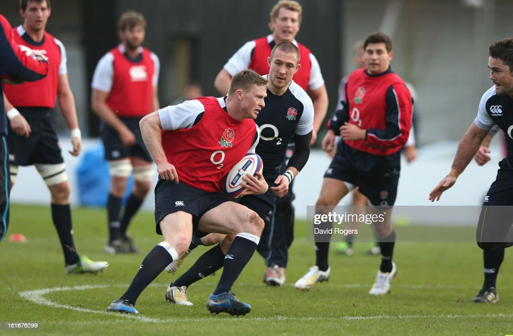 Chris Ashton runs with the ball during the England training session held at St Georges Park on February 14, 2013 in Burton-upon-Trent, England.