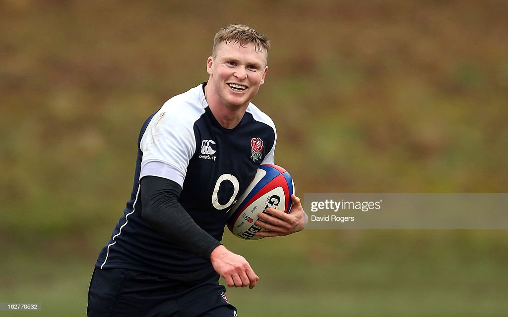 Chris Ashton runs with the ball during the England training session held at Pennyhill Park on February 26, 2013 in Bagshot, England.