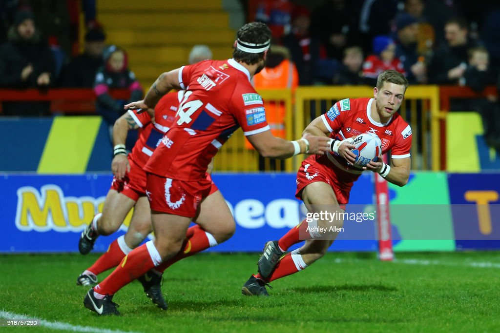 Chris Atkin (R) of Hull KR gathers the ball during the BetFred Super League match between Hull KR and Catalans Dragons at KCOM Craven Park on February 15, 2018 in Hull, England.