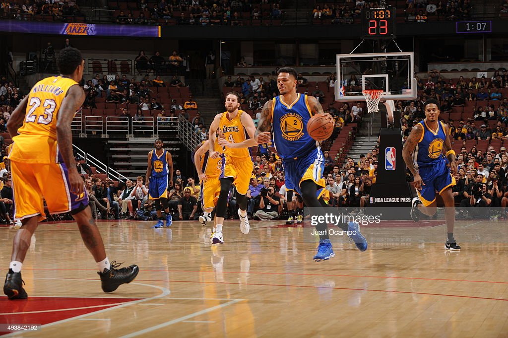 Chris Babb #2 of the Golden State Warriors brings the ball up court against the Los Angeles Lakers during a preseason game on October 22, 2015 at Honda Center in Anaheim, California.