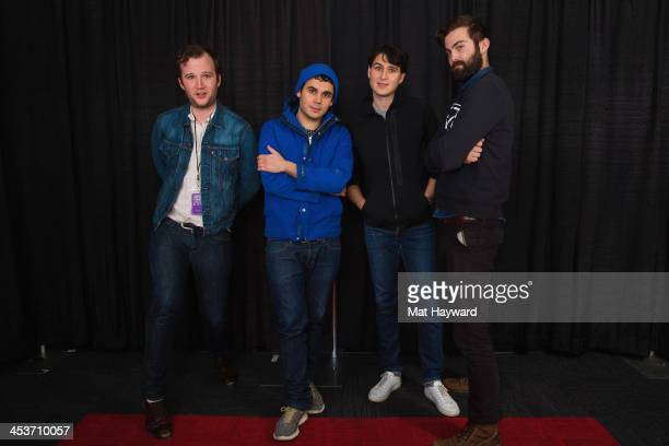 Chris Baio Rostam Batmanglij Ezra Koenig and Chris Tomson of Vampire Weekend pose for a portrait backstage during Deck the Hall Ball hosted by 1077...