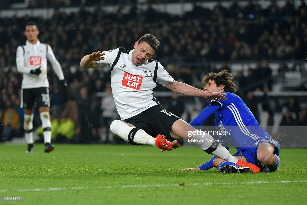 Chris Baird of Derby County falls under a challenge from Diego Fabbrini of Birmingham City during the Sky Bet Championship match between Derby County and Birmingham City at iPro Stadium on December 27, 2016 in Derby, England.