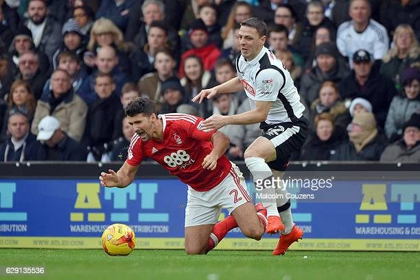 Chris Baird of Derby County fouls Eric Lichaj of Nottingham Forest during the Sky Bet Championship match between Derby County and Nottingham Forest...