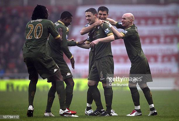 Chris Baird of Fulham celebrates with team mates after scoring his second goal from a free kick during the Barclays Premier League match between...