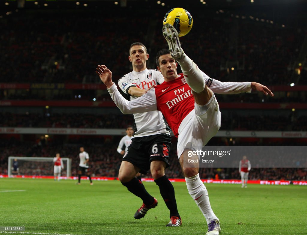 Chris Baird of Fulham looks on as Robin van Persie of Arsenal controls the ball during the Barclays Premier League match between Arsenal and Fulham at Emirates Stadium on November 26, 2011 in London, England.