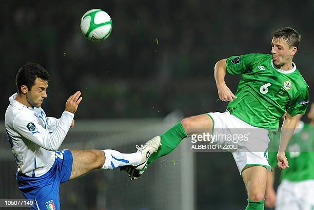 Chris Baird of Northern Ireland vies with Giuseppe Rossi of Italy during the Euro 2012 Group C qualifying football match between Northern Ireland and...