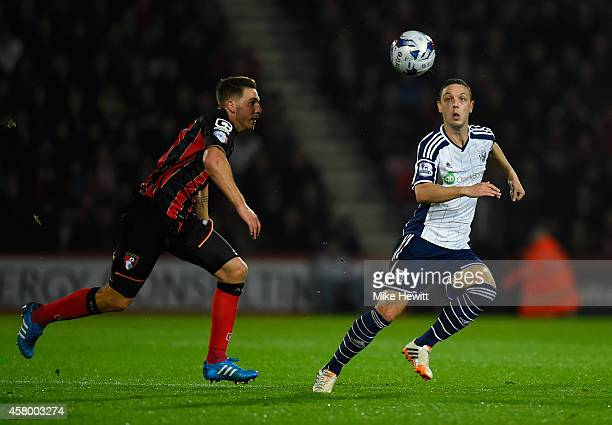 Chris Baird of West Brom and Dan Gosling of Bournemouth compete for the ball during the Capital One Cup Fourth Round match between Bournemouth and...