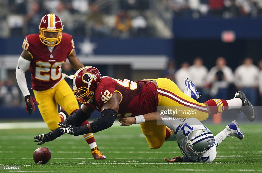 Chris Baker #92 of the Washington Redskins makes a fumble recovery against Kellen Moore #17 of the Dallas Cowboys at AT&T Stadium on January 3, 2016 in Arlington, Texas.
