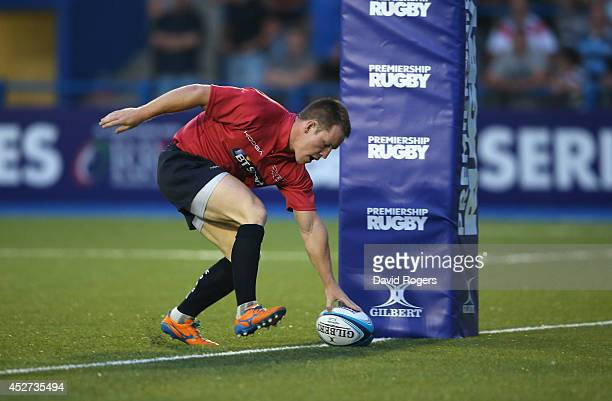 Chris Banfield of the Scarlets scores a try against the Ospreys during the Premiership Rugby 7's Series at the Cardiff Arms Park on July 26 2014 in...