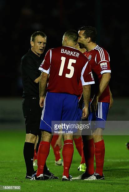 Chris Barker of Aldershot has words with Referee Paul Rees during the Skrill Conference Premier match between Aldershot Town and Luton Town at...