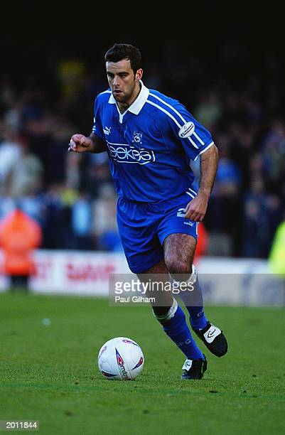Chris Barker of Cardiff City runs with the ball during the Nationwide Second Division playoff semi final second leg match between Bristol City and...
