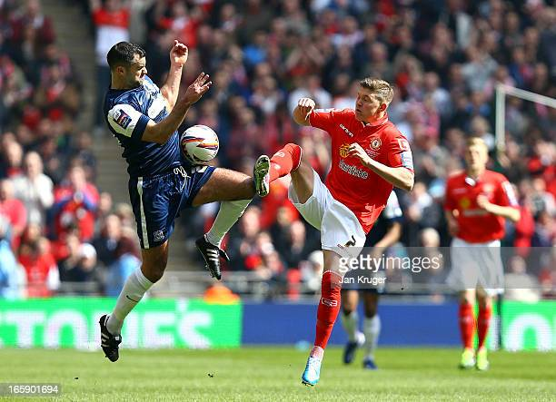 Chris Barker of Southend United collides with Max Clayton of Crewe Alexandra during the Johnstone's Paint Trophy Final match between Crewe Alexandra...