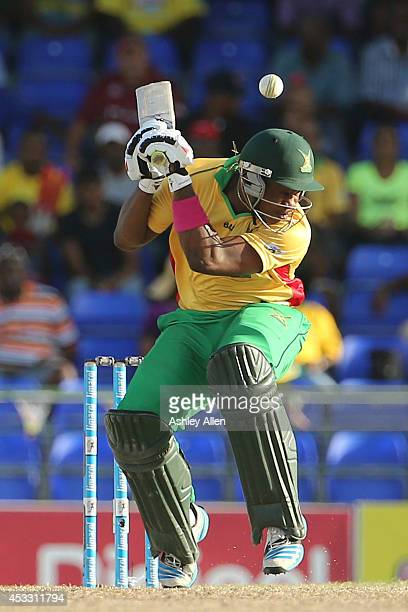 Chris Barnwell of Guyana Amazon Warriors is welcomed to the crease with a bouncer during a match between Guyana Amazon Warriors and Antigua...