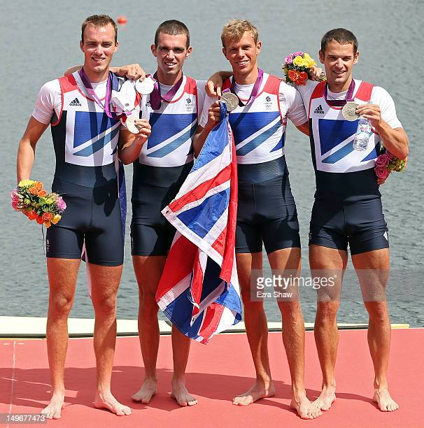 Chris Bartley Richard Chambers Rob Williams and Peter Chambers of Great Britain celebrate with their silver medals during the medal ceremony for the...