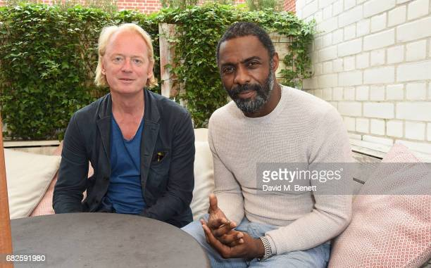 Chris BarŽzBrown and Idris Elba attend the Idris Elba Purdey's campaign launch event at Soho House on May 13 2017 in London England